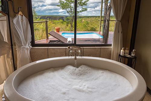 The Elephant Camp West - safari lodge bathroom