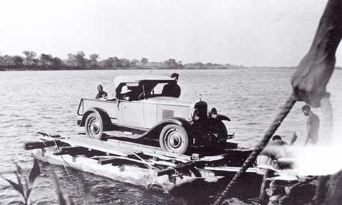 Old car crossing the Zambezi on a ferry